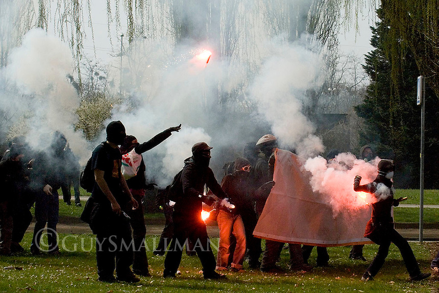 Activists confront riot Police after a hotel was set on fire in the Rue Coulaux Strasbourg during the NATO summit.