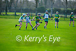 Kerry's Caoimhe Spillane breaks free from the challenges of Tracy King and Claire Coffey of Meath in the Camogie Intermediate Championship