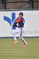 Clemson Tigers right fielder Steven Duggar (9) warms up before a game against the South Carolina Gamecocks at Fluor Field February 28, 2015 in Greenville, South Carolina. The Gamecocks defeated the Tigers 4-1. (Tony Farlow/Four Seam Images)