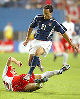 Landon Donovan leaps over a Polish defender. The USA lost 3-1 against Poland in the FIFA World Cup 2002 in Korea on June 14, 2002.