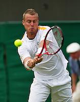 26-06-13, England, London,  AELTC, Wimbledon, Tennis, Wimbledon 2013, Day three, Lleyton Hewitt (AUS)<br /> <br /> <br /> <br /> Photo: Henk Koster