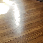 Red Oak flooring scratches from rolltop repositioning in middle of room