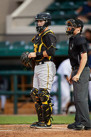 Bradenton Marauders catcher Jason Delay (5) and home plate umpire Tyler Jones during the second game of a doubleheader against the Lakeland Flying Tigers on April 11, 2018 at Publix Field at Joker Marchant Stadium in Lakeland, Florida.  Bradenton defeated Lakeland 1-0.  (Mike Janes/Four Seam Images)