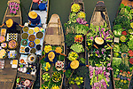 Floating market vendors, Bangkok, Thailand<br /> Floating markets are a common tradition throughout Southeast Asia where the numerous rivers and waterways are a primary means of transportation and commerce between villages. In this overhead view, Bangkok vendors draw their boats together to exchange a colorful, tasty array of goods, Thailand.