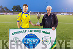 Killorglin AFC captain Lee Carey accepts the Denny Premier B League Cup from John O'Regan (KDL Sec) as they took the honours against Camp United in the Denny Premier B League Final