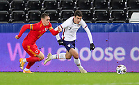 SWANSEA, WALES - NOVEMBER 12: Giovanni Reyna #7 of the United States  get's after a ball during a game between Wales and USMNT at Liberty Stadium on November 12, 2020 in Swansea, Wales.