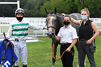 Winner of The British Stallion Studs EBF Upavon Fillies' Stakes  Alpinistar (white) ridden by Ryan Tate and trained by Sir Mark Prescott  in the Winners enclosure during Horse Racing at Salisbury Racecourse on 13th August 2020