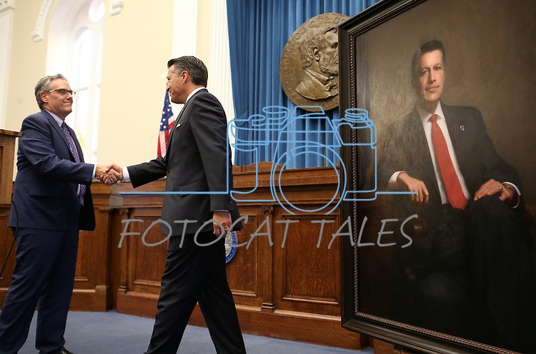 Dale Erquiaga congratulates Gov. Brian Sandoval during a ceremony to unveil his official portrait at the Capitol in Carson City, Nev., on Thursday, Oct. 25, 2018. <br /> Photo by Cathleen Allison/Nevada Momentum