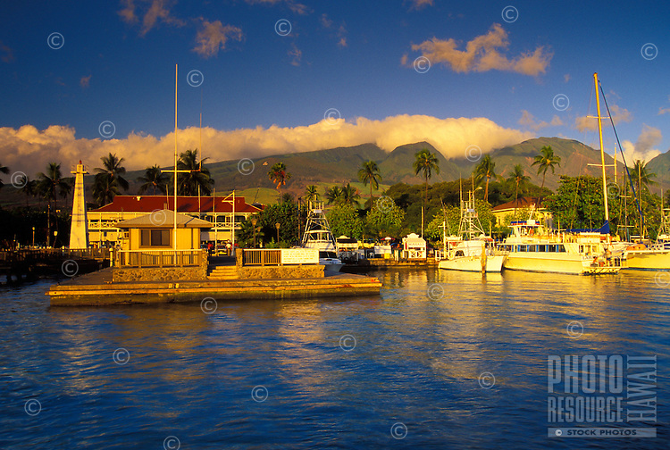 Lahaina Harbor and the Pioneer Inn in front of the West Maui Mountains at sunset