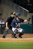 Northwest Arkansas Naturals catcher Luis Villegas (19) and home plate umpire Tyler Olson during a game against the Midland RockHounds on May 27, 2017 at Arvest Ballpark in Springdale, Arkansas.  NW Arkansas defeated Midland 3-2.  (Mike Janes/Four Seam Images)