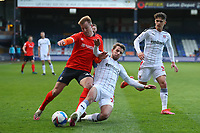 4th May 2021; Kenilworth Road, Luton, Bedfordshire, England; English Football League Championship Football, Luton Town versus Rotherham United; Dan Barlaser of Rotherham United tackles James Bree of Luton Town