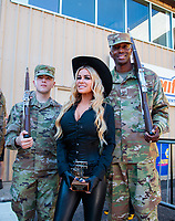 Jul 21, 2019; Morrison, CO, USA; TV/movie actress Carmen Electra (center) poses with US Army soldiers during the NHRA Mile High Nationals at Bandimere Speedway. Mandatory Credit: Mark J. Rebilas-USA TODAY Sports