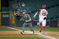 Baylor Bears first baseman Chase Wehsener (37) stretches for a throw as Christian Franklin (25) of the Arkansas Razorbacks hustles down the line during game nine of the 2020 Shriners Hospitals for Children College Classic at Minute Maid Park on March 1, 2020 in Houston, Texas. The Bears defeated the Razorbacks 3-2. (Brian Westerholt/Four Seam Images)