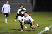 Manny Sardinha (14) of the Princeton Tigers goes airborne from a tackle y Andrew Bulls (17) of the UMBC Retrievers. UMBC Retrievers defeated Princeton Tigers 2-1 during the first round of the 2010 NCAA Division 1 Men's Soccer Championship at Roberts Stadium in Princeton, NJ, on November 18, 2010.