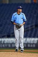 Charlotte Stone Crabs relief pitcher Yonny Chirinos (15) gets ready to deliver a pitch during a game against the Clearwater Threshers on April 12, 2016 at Bright House Field in Clearwater, Florida.  Charlotte defeated Clearwater 2-1.  (Mike Janes/Four Seam Images)