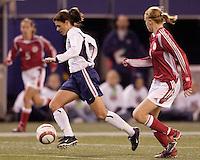 """Mia Hamm races past Denmark's Gitte Andersen. The US Women's National Team tied the Denmark Women's National Team 1 to 1 during game 8 of the 10 game the """"Fan Celebration Tour"""" at Giant's Stadium, East Rutherford, NJ, on Wednesday, November 3, 2004.."""
