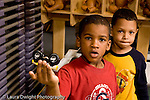 Education Preschool 4-5 year olds boy holding toy vehicle serious friend behind him horizontal
