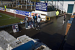 Greenock Morton 2 Stranraer 0, 21/02/2015. Cappielow Park, Greenock. Programme sellers awaiting spectators at the home end of the ground before Greenock Morton take on Stranraer in a Scottish League One match at Cappielow Park, Greenock. The match was between the top two teams in Scotland's third tier, with Morton winning by two goals to nil. The attendance was 1,921, above average for Morton's games during the 2014-15 season so far. Photo by Colin McPherson.