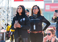 Nov 1, 2019; Las Vegas, NV, USA; Janae Salinas (left) and Monica Salinas watch NHRA top alcohol dragster driver Jasmine Salinas (not pictured) during qualifying for the Dodge Nationals at The Strip at Las Vegas Motor Speedway. Mandatory Credit: Mark J. Rebilas-USA TODAY Sports
