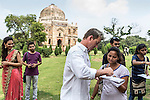 8 October 2013, New Delhi, India. Recently retired Australian cricket star Brett Lee signs an autograph for local girl Pinky Singh before a scratch game of tennis ball cricket in front of a Mughal era tomb in the famous Lodi Gardens in New Delhi. His arrival caused great interest in the local boys in the grounds. He is in India to show off his latest fashion lines and to foster greater interest in Australian - Indian business interactions.  Picture by Graham Crouch