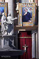 "A tapestry hanged on the facade of St Peter's basilica shows a portrait of French Salomon Leclercq during a canonization mass.Pope Francis  leads a canonization mass on October 16, 2016 at St Peter's square in Vatican. Pope Francis canonises Argentine ""gaucho priest"" Jose Gabriel Brochero today along with six others raised to sainthood : Salomon Leclercq, Jose Sanchez del Río, Manuel Gonzalez Garcia, Lodovico Pavoni, Alfonso Maria Fusco and Elizabeth of the Trinity."