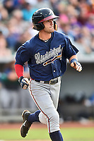 Mississippi Braves shortstop Dansby Swanson (7) runs to first base during a game against the Tennessee Smokies at Smokies Stadium on July 23, 2016 in Kodak, Tennessee. The Braves defeated the Smokies 3-0. (Tony Farlow/Four Seam Images)