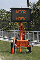 PALM BEACH, FL - FEBRUARY 28: A digital alert sign asking drivers and riders to wear a mask  on the road as Donald Trump heads to CPAC (Conservative Political Action Conference) 2021 on February 28, 2021 in Palm Beach, Florida. Credit: mpi34/MediaPunch