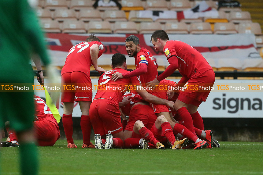 O's Jobi McAnuff celebrates with team mates after James Brophy scored the late winner during Port Vale vs Leyton Orient, Sky Bet EFL League 2 Football at Vale Park on 28th November 2020