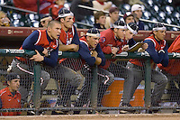 The Houston Cougars bench tries the rally cap look in the 9th inning versus the Texas A&M Aggies in the 2009 Houston College Classic at Minute Maid Park March 1, 2009 in Houston, TX.  The Aggies defeated the Cougars 5-3. (Photo by Brian Westerholt / Four Seam Images)