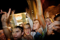 Students, at an outside screening, cheer and shout in response to the appearance of the Moldovan entrants to the annual Eurovision Song Contest. Although scorned in much of Western Europe the competition is taken much more seriously in Eastern European countries.