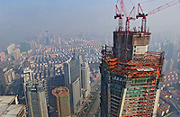 The ongoing construction work on the Mori Tower, or the Shanghai World Financial Centre, Shanghai, China. The 101-storey building is due to be completed in 2008 and will be the world's tallest.