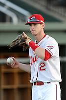 Center fielder Danny Mars (12) of the Greenville Drive warms up before a game against the Charleston RiverDogs on Thursday, August 21, 2014, at Fluor Field at the West End in Greenville, South Carolina. Mars is a sixth-round pick of the Boston Red Sox in the 2014 First-Year Player Draft out of Chipola College. Charleston won, 12-0. (Tom Priddy/Four Seam Images)