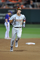 Florida State Seminoles shortstop Justin Gonzalez #10 rounds the bases after homering in the 7th inning of a game against the Clemson Tigers at Doug Kingsmore Stadium on March 22, 2014 in Clemson, South Carolina. The Seminoles defeated the Tigers 4-3. (Tony Farlow/Four Seam Images)