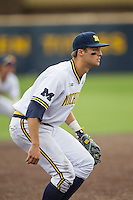 Michigan Wolverines third baseman Jake Bivens (18) on defense against the Toledo Rockets on April 20, 2016 at Ray Fisher Stadium in Ann Arbor, Michigan. Michigan defeated Bowling Green 2-1. (Andrew Woolley/Four Seam Images)