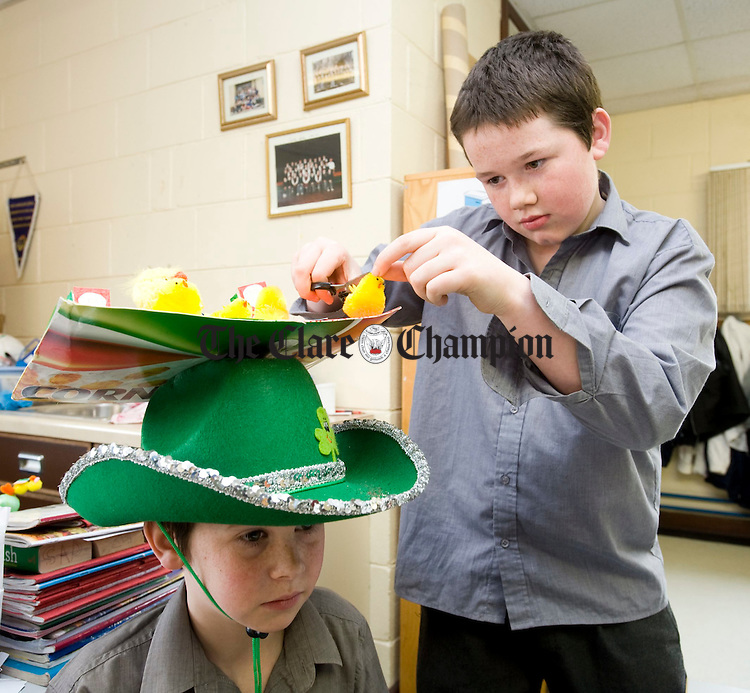 Damien Carey and Johnathan Cusack preparing their Easter bonnetts for the annual Easter parade at Kilrush National school. Photograph by John Kelly.