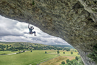 Neil Gresham on Freakshow 8c at Kilnesey, UK <br /> The great brooding limestone cliff of Kilnsey is recognised as one of the UK's most impressive crags. Its most distinctive feature is an enormous roof that caps the already severely overhanging South Buttress. This feature was first aid climbed in the 50s but shot to prominence in 1988 when it was freed by Mark Leach to give Mandela – so named as 'they said it would never go free'. This summer Neil Gresham added his own take on Kilnsey Main Overhang but at a much higher grade with his route Freakshow. 8c in difficulty Freakshow is very different to your typical British sport route – almost 40m in length and with 18 clips the route climbs like the Spanish ultra endurance routes currently defining modern sport climbing. Success for Neil came after 14 days of effort.