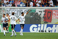 Clint Dempsey (8) acknowledges the U.S. fans following the U.S. goal in the first half. The USA and Italy played to a 1-1 tie in their FIFA World Cup Group E match at Fritz-Walter-Stadion, Kaiserslautern, Germany, June 17, 2006.