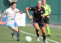Allie Long #9 of the Washington Freedom gets away from Karen Carney #14 of the Chicago Red Stars during a WPS match at RFK stadium on June 13 2009 in Washington D.C. The game ended in a 0-0 tie.