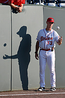 Pitching coach Bob Kipper of the Greenville Drive tosses a ball as he waits for the start of a game against the Kannapolis Intimidators on Wednesday, May 9, 2018, at Fluor Field at the West End in Greenville, South Carolina. Kannapolis won, 10-2. (Tom Priddy/Four Seam Images)