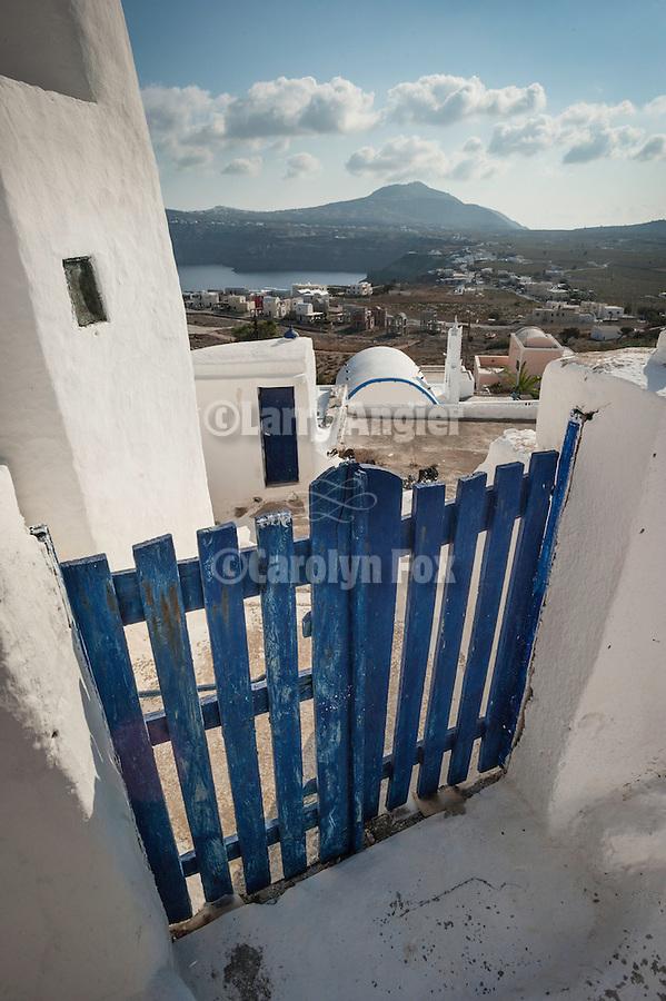 Blue gate and the landscape of Akrotiri, Thira, Santorini