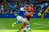 Sheffield Wednesday's forward Gary Hooper (14) tries to turn Barnsley's midfielder Joe Williams (4) during the Sky Bet Championship match between Sheff Wednesday and Barnsley at Hillsborough, Sheffield, England on 28 October 2017. Photo by Stephen Buckley / PRiME Media Images.