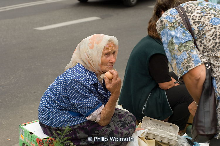 A peasant woman sells eggs and other agricultural produce at a market in Lublin.