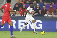ORLANDO, FL - NOVEMBER 15: Alphonso Davies #12 of Canada moves with the ball during a game between Canada and USMNT at Exploria Stadium on November 15, 2019 in Orlando, Florida.
