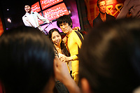 CHINA. Hong Kong. A tourist posing for a photograph with a waxwork of Bruce Lee, at Madame Tussaud's. Officially the Hong Kong Special Administrative Region, it is a territory located on China's south coast on the Pearl River Delta. It has a population of 6.9 million people, and is one of the most densely populated areas in the world. 2008