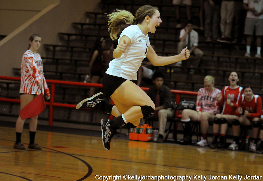 kelly.jordan@jacksonville.com-10-03-12--Bishop Kenny's Abby Boll, (1),jumps in excitement over a crucial point during their match against Episcopal at Bishop Kenny Wednesday night, October 3, 2012 in Jacksonville, Florida.(The Florida Times-Union, Kelly Jordan)