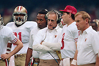 NEW ORLEANS, LA - Head coach George Seifert of the San Francisco 49ers coaches his team and talks with Steve Young during Super Bowl XXIV against the Denver Broncos at the Superdome in New Orleans, Louisiana on January 28, 1990. Photo by Brad Mangin.