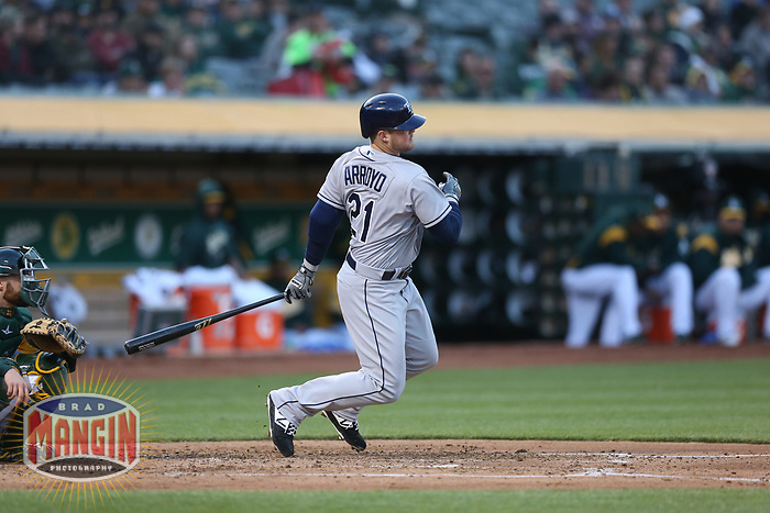 OAKLAND, CA - MAY 30:  Christian Arroyo #21 of the Tampa Bay Rays bats against the Oakland Athletics during the game at the Oakland Coliseum on Wednesday, May 30, 2018 in Oakland, California. (Photo by Brad Mangin)