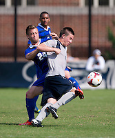 Alex Muyl (9) of Georgetown fights for the ball with Christian Battistesa (24) of Seton Hall during the game at Shaw Field in Washington, DC.  Georgetown defeated Seton Hall, 8-0.