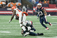 FOXBOROUGH, MA - OCTOBER 27: Cleveland Browns Runningback Dontrell Hilliard #25 tackled by New England Patriots Linebacker Jamie Collins #58 during a game between Cleveland Browns and New Enlgand Patriots at Gillettes on October 27, 2019 in Foxborough, Massachusetts.