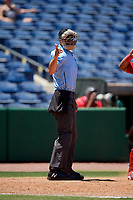 Home plate umpire Dillon Wilson calls a strike during a game between the Fort Myers Miracle and the Clearwater Threshers on April 25, 2018 at Spectrum Field in Clearwater, Florida.  Clearwater defeated Fort Myers 9-5.  (Mike Janes/Four Seam Images)